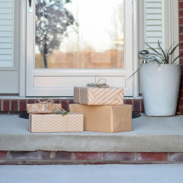 four-brown-gift-boxes-near-a-glass-paneled-door-with-wreath-712319